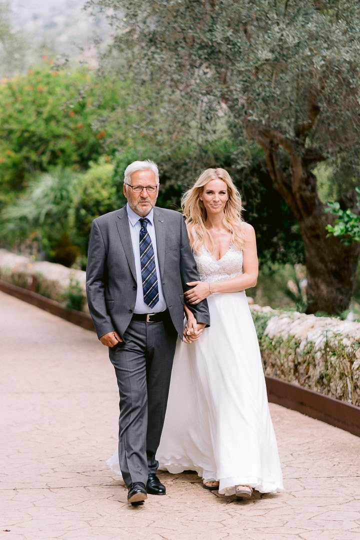 Bride arrives at Ceremony with ther father at this Wedding at S'Olivaret Venue in Mallorca