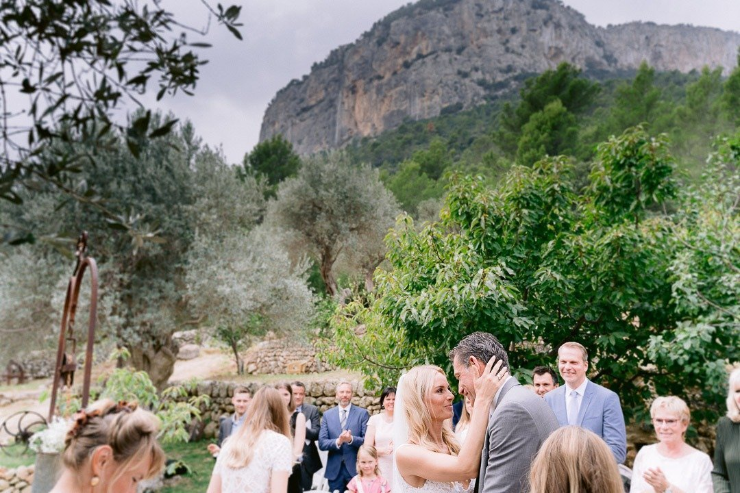 The gardens was the place chosen for this Bride arrives at Ceremony with ther father at this Wedding at S'Olivaret Venue in Mallorca