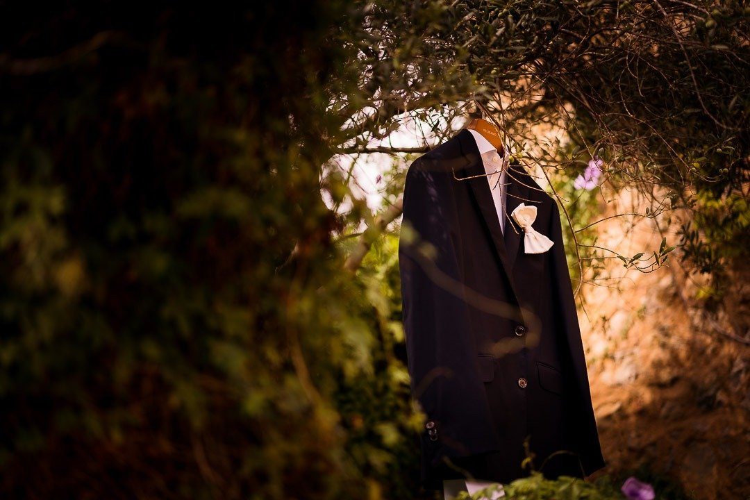 Groom's Suit on a tree awaiting the moment at Mallorca Destination Wedding Photography