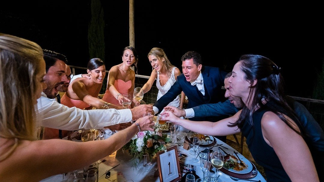 Bride and Groom toast with friends and family. Destination Wedding Photography at Son Simo Vell Finca
