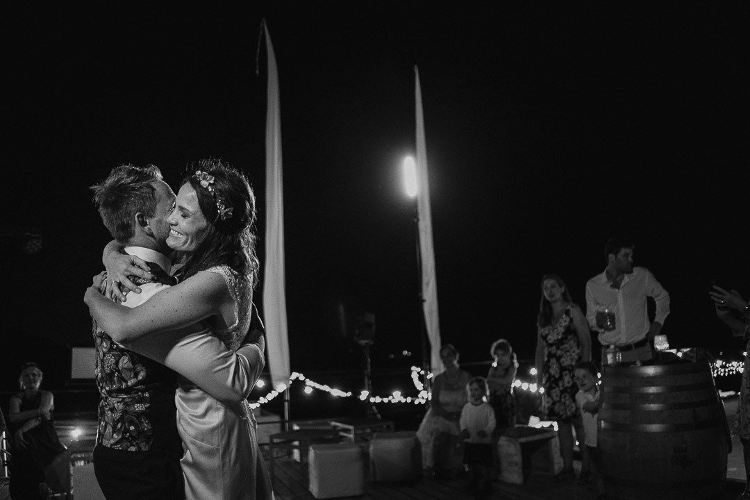 The Bride and Groom Hug each other at their first dance at Ses Voltes Wedding Venue in Mallorca