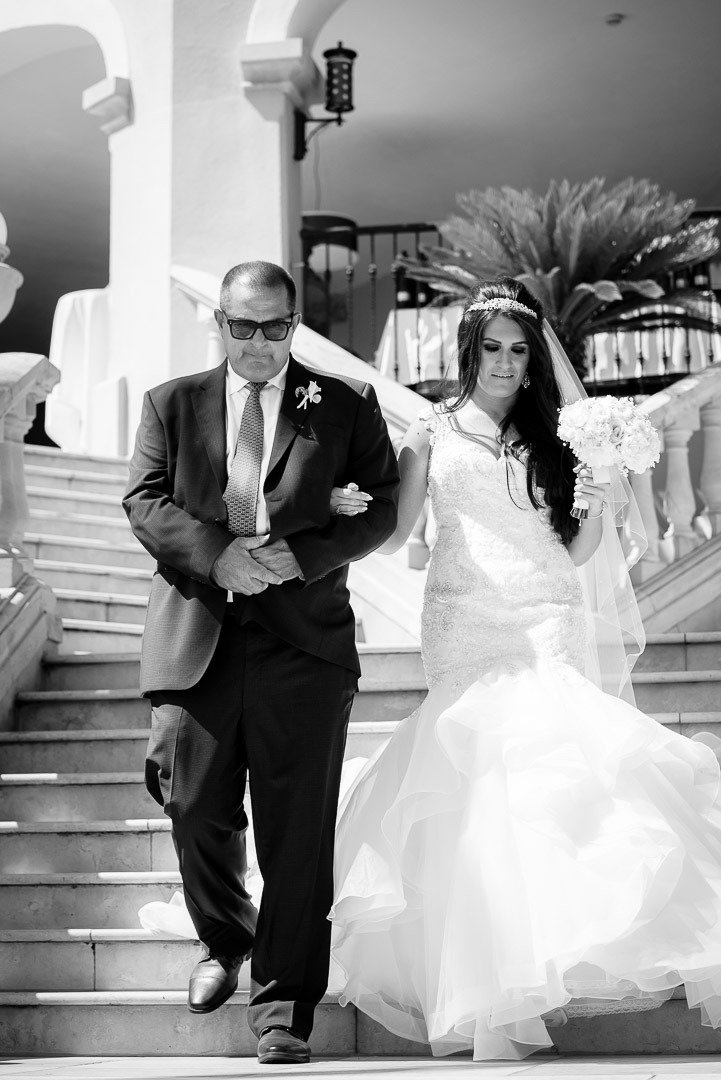 Bride is steps away from Wedding altar at St Regis Mardavall Venue