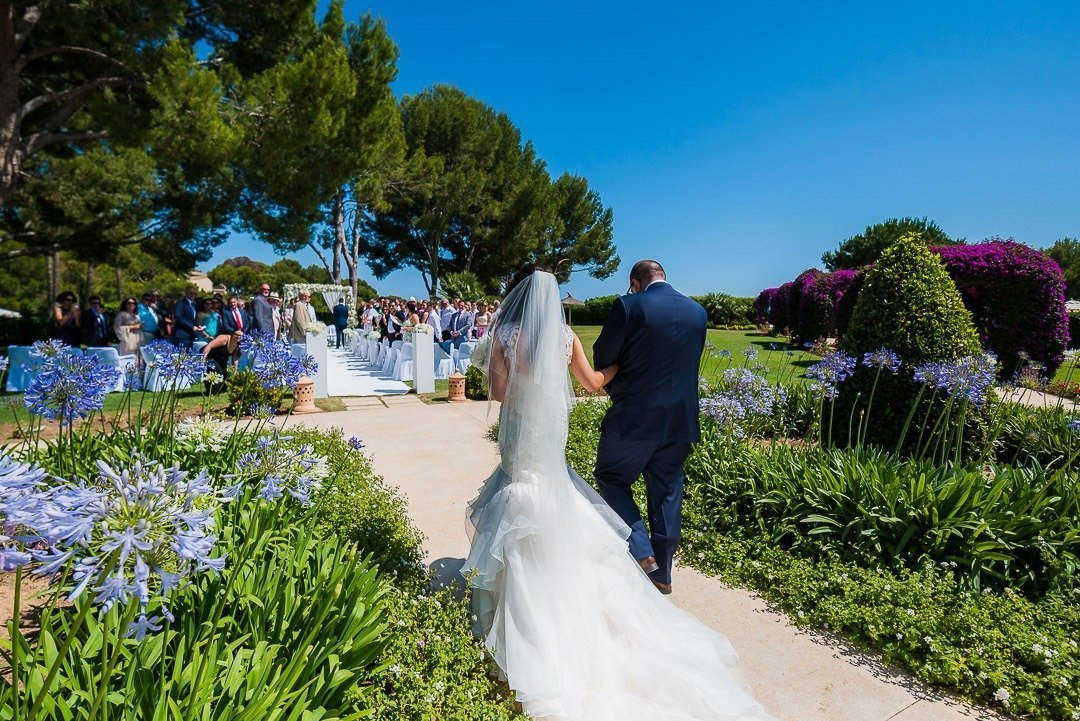 Alking holding dad to her Wedding Ceremony in Mallorca. Organized by Lane Productions