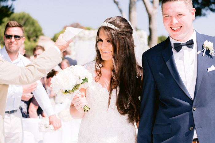 Bride and Groom newly wed leave ceremony at this impressive Wedding. Expert Wedding Planner Lane Productions
