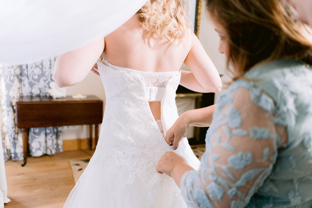 Bridal Gown being put on at Destination Wedding Mallorca. Studio Photography